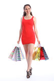 Long legged young woman walking with shopping bags Stock Photography