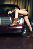 Long legs. Portrait of a styled professional model in a car session Royalty Free Stock Images