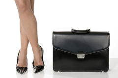 Long legs of business woman. Long legs of sensual business woman with black suitcase Royalty Free Stock Image