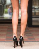 Long legs and high heeled shoes Stock Photos