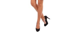 Long legs in high heels. Isolated Stock Images