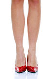 Long legs and red shoes Stock Images