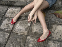 Long legs with red shoes Royalty Free Stock Image