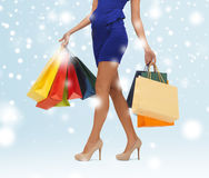 Long legs with shopping bags Stock Photography