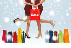 Long legs with shopping bags Stock Photo