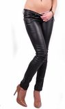 Long legs in skinny leather pants and high heel Stock Image