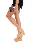 The long legs of a woman standing. Royalty Free Stock Photo