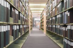 Long library aisle defocused Royalty Free Stock Image