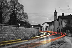Long lights tight curve. Long lights dangerous curve in a small village during the dawn Royalty Free Stock Images