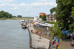 A long line of book stalls crowded with people along the riversi Royalty Free Stock Images