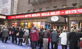 Long Line for Broadway Show. The Broadway Revival of a musical, Hello Dolly with Bette Midler,attracts many tourists and visitors who are waiting in a long line Royalty Free Stock Image