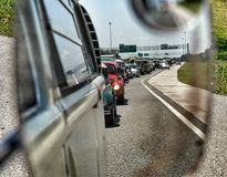 Long line of cars in rearvew mirror. Stock Photo