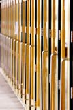 Long Line of Doors (Vertical). A Long Line of Steel and Glass Doors on a Large Building That Hosts Events in a Metro Area (shallow focus stock photography
