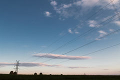 A long line of electrical transmission towers Royalty Free Stock Image