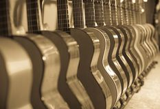 Long line of new acoustic guitars in store. Long row of new acoustic guitars in music chop Royalty Free Stock Photography