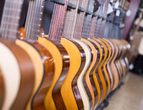 Long line of new acoustic guitars in store Stock Photo