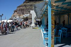 Long line of people waiting to embark on a tender to go on a cruise ship. Harbor of Santorini with a long line of people waiting to embark on a tender to go on a stock images