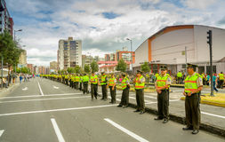 Long line police officers guarding the street as Royalty Free Stock Images