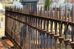 Long line of rusty spikes on metal fencing Royalty Free Stock Image