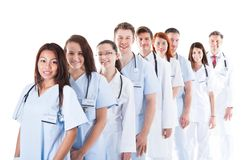 Long line of smiling doctors and nurses Stock Photography