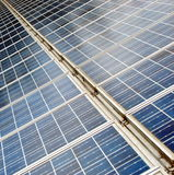 Long line of solar panels to produce electricity Stock Image