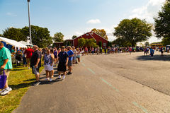 Long Line at the Whoopie Pie Festival. Ronks, PA - September 10, 2016: A long line of people await entry to pie tent at the Whoopie Pie Festival at Hershey Farms Royalty Free Stock Photos