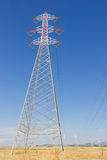 Long lines of power-line tower. Stretching across a blue Sky Royalty Free Stock Photography