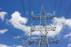 Long lines of powerline tower. Stretching across a blue Sky Stock Images