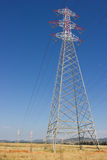 Long lines of powerline tower. Blue summer sky Royalty Free Stock Photos