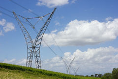 Long lines of powerline towers. Stretching across a beautiful countryside Royalty Free Stock Photos