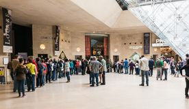 Long lines wait to go through security at the underground Louvre Stock Photos