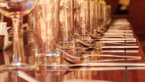 Long lines of wine glasses on restaurant table with napkins stock video footage