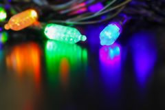 The lights of a colored garland. Royalty Free Stock Photography