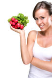 Long live healthily - Beautiful woman holding a bunch of radishes Stock Images