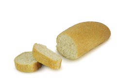 Long loaf of bread sliced isolated on white background Stock Photos