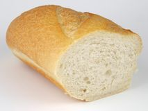 Long loaf bread. On a white background Royalty Free Stock Image