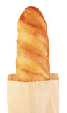 Long loaf in paper bag Royalty Free Stock Photos