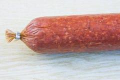 Long loaf the smoked sausage Stock Image