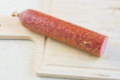 Long loaf the smoked sausage Royalty Free Stock Images
