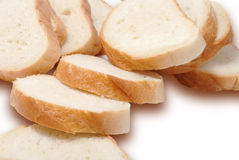 A long loaf of white bread cut into pieces Royalty Free Stock Image