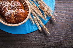 Long loaf in wicker basket wheat rye ears with Royalty Free Stock Images