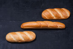 Long loafs on black board Royalty Free Stock Images