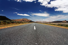 Long, lonely road Stock Images