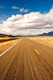 Long Long Road In Desert Storm Royalty Free Stock Photos