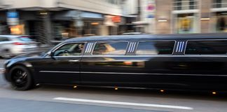 Long luxury limousine speeding in the city Stock Photos