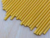 Long macaroni italian style. On wood background Royalty Free Stock Photo