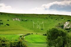 Long Man of Wilmington hill figure. Long Man of Wilmington, a historic chalk cut figure on a hillside in East Sussex, England stock images
