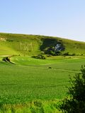 Long Man of Wilmington. Portrait view of the Long Man of Wilmington, a historic carved figure of unknown origin made in the chalk hillside in East Sussex Stock Photos