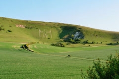 Long Man of Wilmington. Rural landscape of the Long Man of Wilmington, a historic carved figure of unknown origin made in the chalk hillside in East Sussex royalty free stock photography