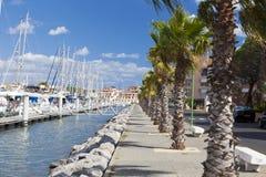 The long marina promenade in Gruissan Stock Photography